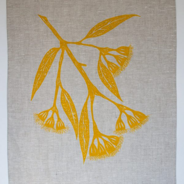 100% linen tea towel with yellow gum blossom print